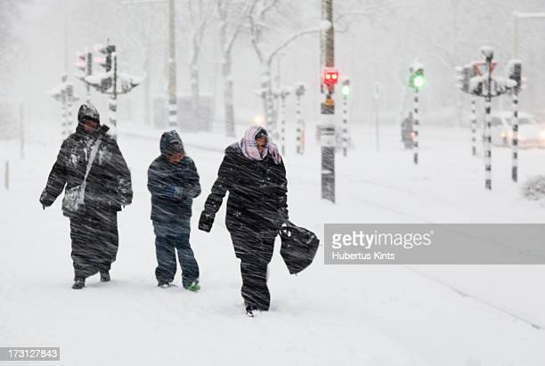 CONTENT] Three people walking in a snow storm that disrupted traffic and public transport in The Hague Netherlands december 2010