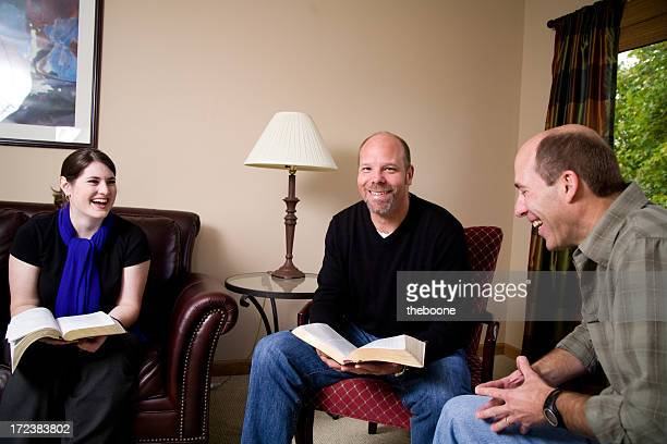 three people with bibles - free bible image stock pictures, royalty-free photos & images