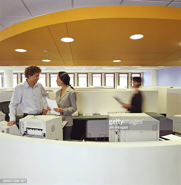 Three people working in office (blurred motion)