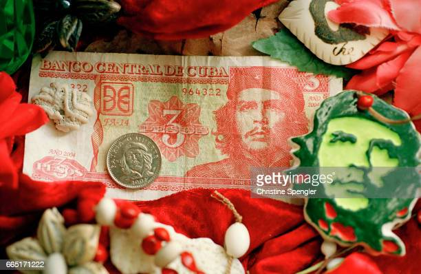 Three peso bank note representing Ernesto Che Guevara a coin and a badge Cubans sell to tourists