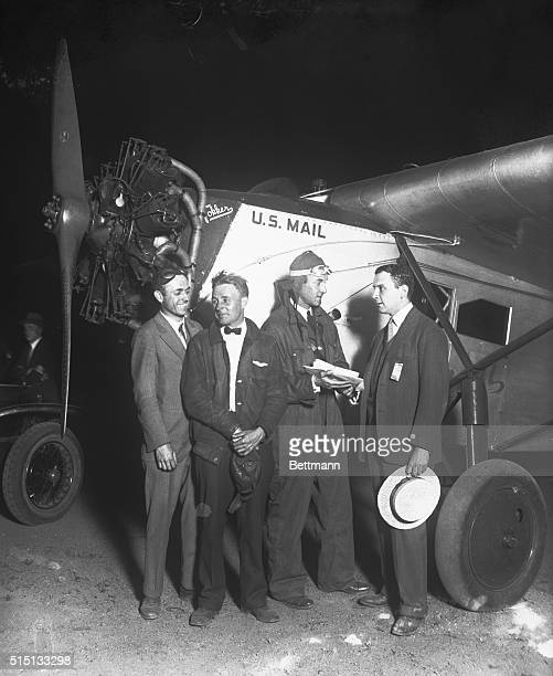 Three pilots for Colonial Air Transport Inc are congratulated by Managing Director Juan T Trippe following their successful first airmail trip...