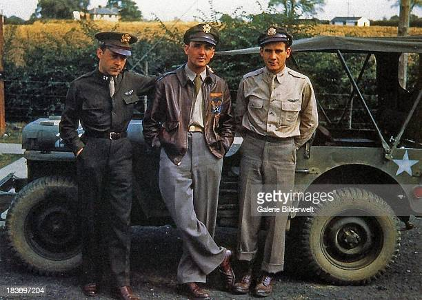 Three pilots of the 332nd Bomb Group US Army 9th Air Force posing in front of a Jeep at Great Sailing Essex 1944