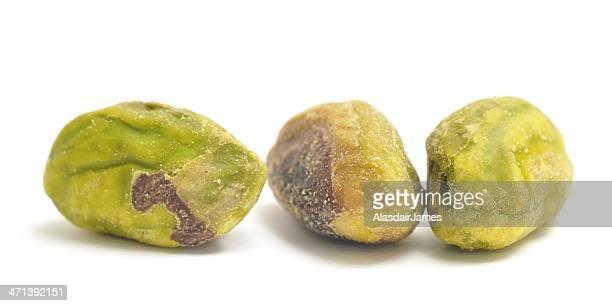 Three Pistachio nuts shelled