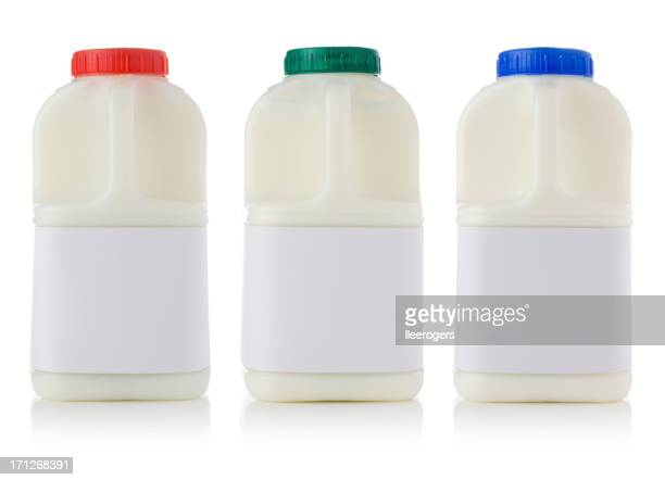 Three plastic bottled pints of fresh milk with blank labels