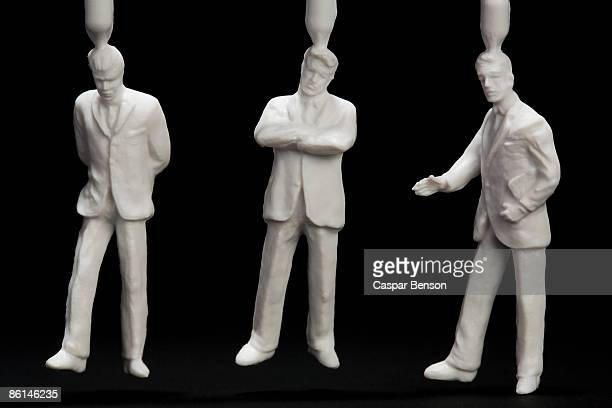 three plastic businessmen figurines - human representation stock pictures, royalty-free photos & images