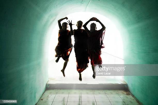 Three playful monks