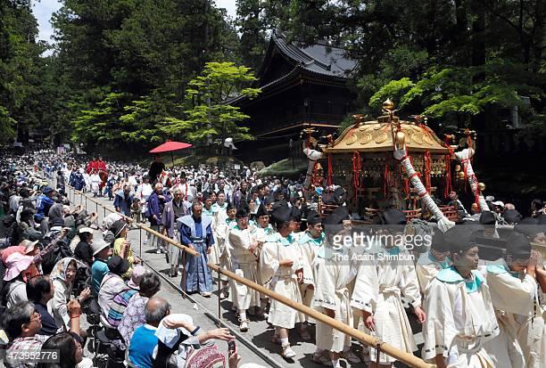 Three portable shrines dedicated to Tokugawa Ieyasu Toyotomi Hideyoshi and Minamoto no Yoritomo are paraded down the 1kilometre approach to Nikko...