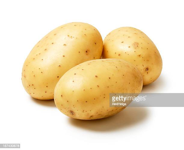 three potatoes - raw potato stock pictures, royalty-free photos & images