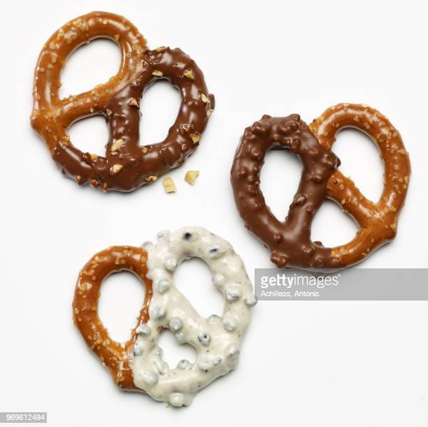 three pretzels dipped in white and dark chocolate - chocolate dipped stock pictures, royalty-free photos & images