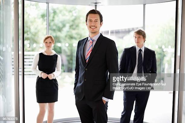 Three professional people standing