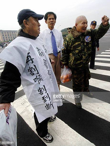 Three prounification demonstrators protest outside the Taipei Guest House where Taiwan President Chen Shuibian is meeting with opposition leader...