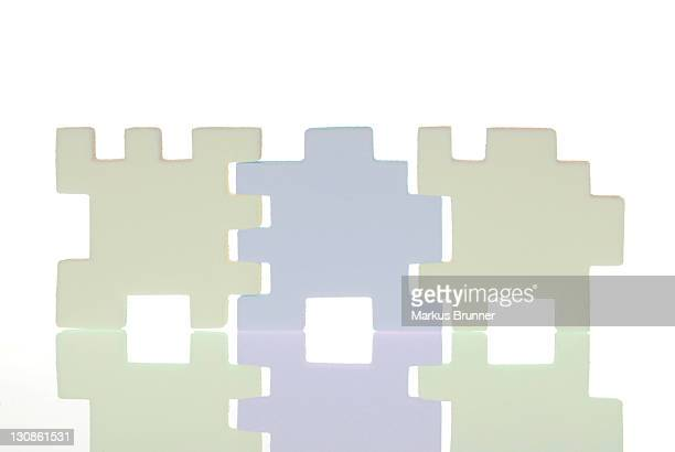 Three puzzle pieces fit together