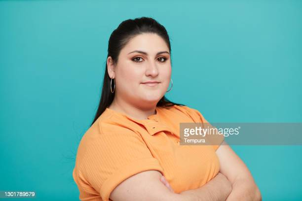 three quarter front view of a woman in a polo shirt. - polo shirt stock pictures, royalty-free photos & images
