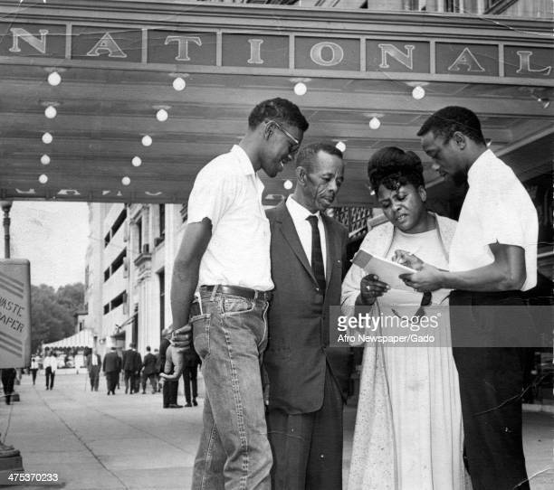 A three quarter length portrait of civil rights leader Fannie Lou Harmer with three men June 16 1964