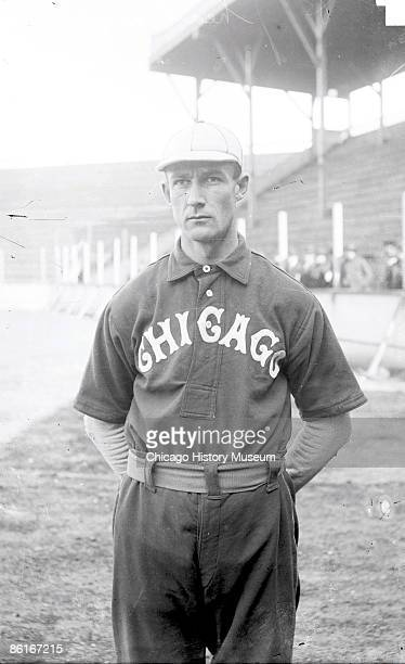 Three quarter length portrait of Fielder Jones outfielder for the Chicago White Sox American League standing near bleachers at South Side Park...