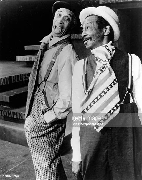 Three quarter length portrait of Joseph Attles, left, and Avon Long, right, on stage performing in the Broadway Musical 'Bubbling Brown Sugar' at the...