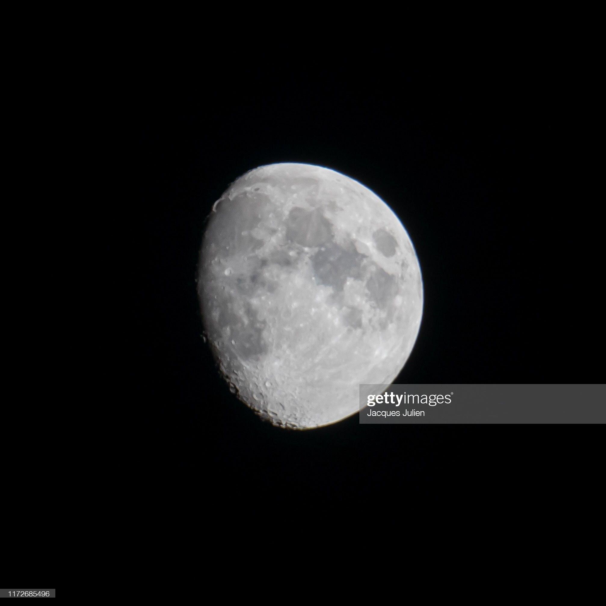 Three quarter moon isolated against a black sky : Photo