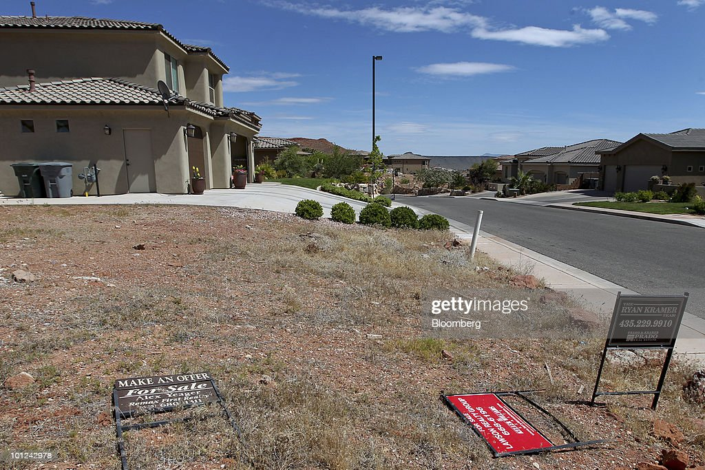 Three realtor signs sit on an undeveloped home lot for sale in St. George, Utah, U.S., on Wednesday, May 26, 2010. Housing starts rose to a 672,000 annual rate last month, the highest since October 2008 and up 5.8 percent from March, Commerce Department figures showed this month. After almost five years of falling sales and prices, homebuilders are looking to see if the nation's fledgling economic recovery can sustain the real estate market as government subsidies end. Photographer: George Frey/Bloomberg via Getty Images