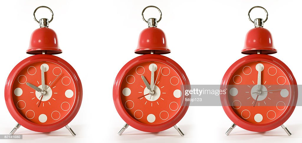 Three Red Alarm Clocks Stock Photo