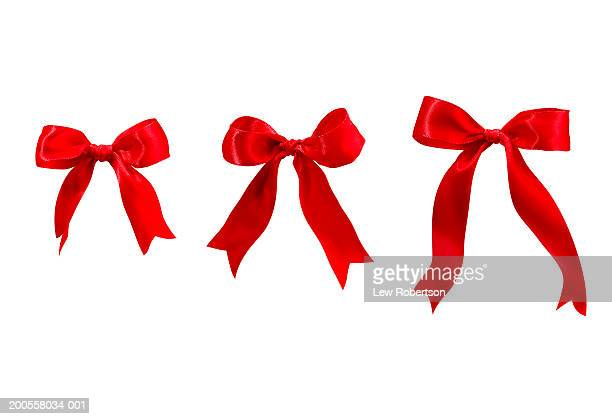 three red bows - tied bow stock pictures, royalty-free photos & images