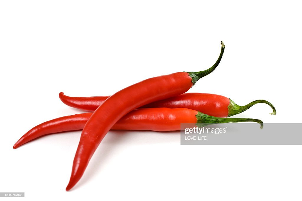 Three red chili peppers on a white background : Stock Photo