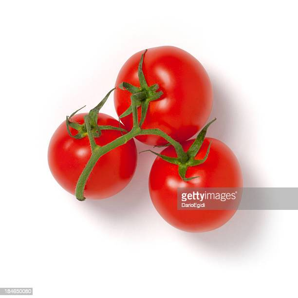 Three red little 'ciliegino' tomatoes on white background