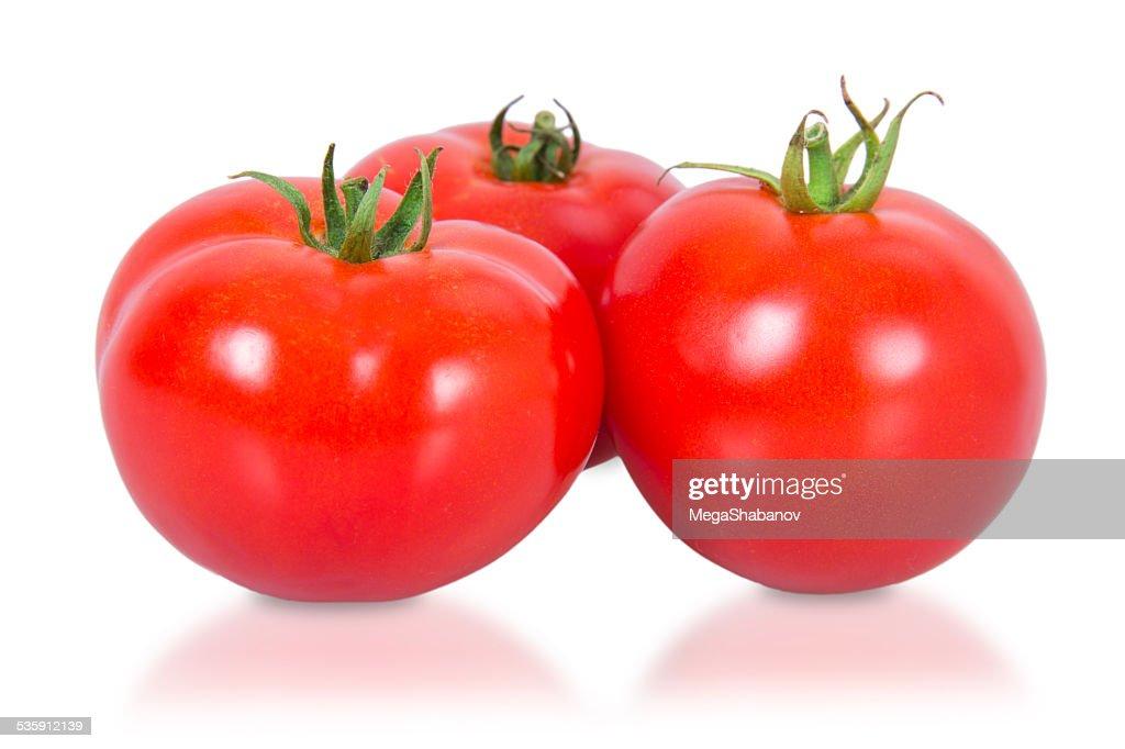 Three red tomatoes : Stock Photo