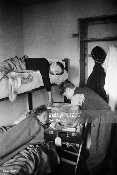 Three refugee children at a holiday camp at Dovercourt Bay near Harwich after arriving in Britain December 1938 They are part of the Kindertransport...