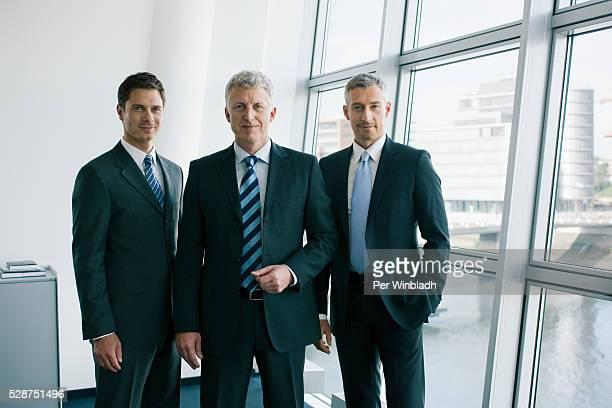 three reliable businessmen - drei personen stock-fotos und bilder