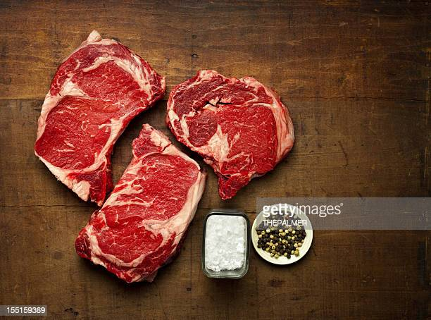 three rib-eye steaks