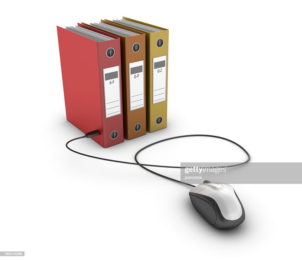 Three ring binders and a corded computer mouse : Stock Photo