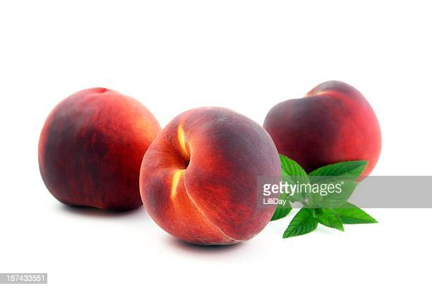 Three Ripe Peaches and Mint Leaves