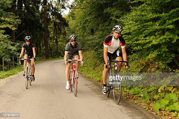 Three road cyclists exercising