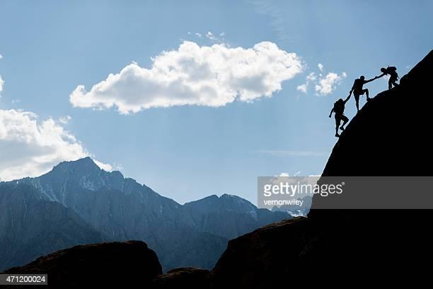 Three rock climbers