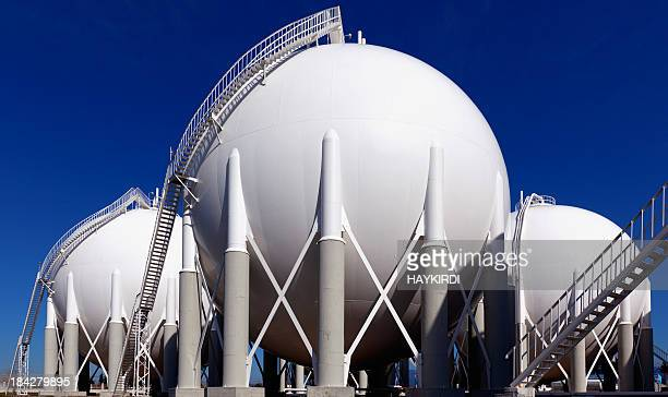 three round holding tanks at petrochemical plant - armored tank stock photos and pictures