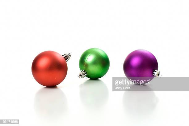 Three round holiday ornaments