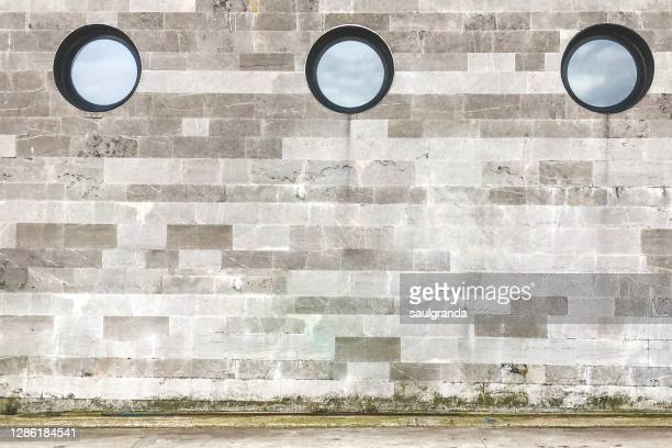 three round windows on a facade - three objects stock pictures, royalty-free photos & images