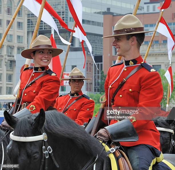 Three Royal Canadian Mounted Police riders commiserate after an event on the Canadian Parliament Hill. The Musical Ride. Canada Day.