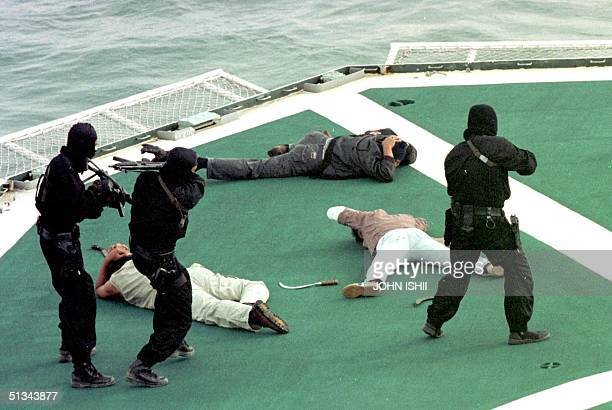 Three Royal Malaysian Police Marine Comandos caputure several pirates who have hijacked the Japan Coast Guard Vessel PLH SHIKISHIMA during a...