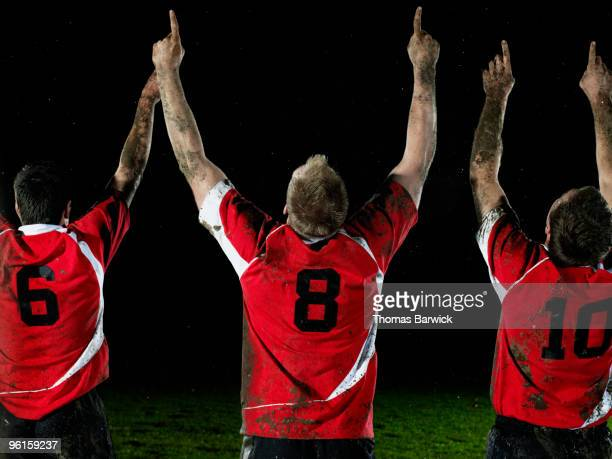 three rugby players celebrating with arms raised - rugby union 個照片及圖片檔