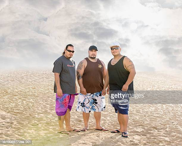 three samoan surfers on beach, portrait - fat guy on beach stock pictures, royalty-free photos & images