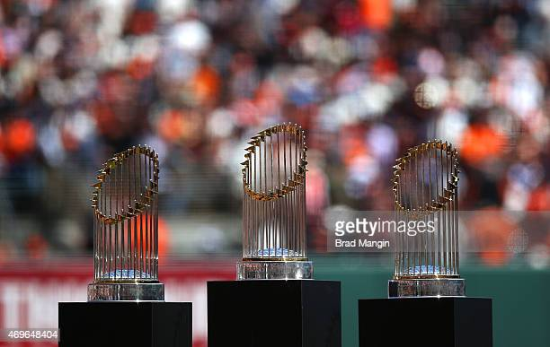 Three San Francisco Giants World Series trophies from 2010 and 2014 sit on the field for pregame ceremonies before the game against the Colorado...