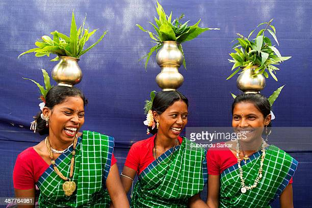 Three Santhali women share a joke before getting ready for a dance during a festive celebration The Santhal are the largest tribal community in India...