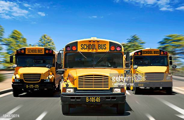 three school buses driving towards camera - education stock pictures, royalty-free photos & images