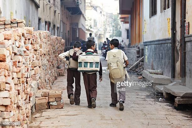 Three schoolboys on way to school in Varanasi