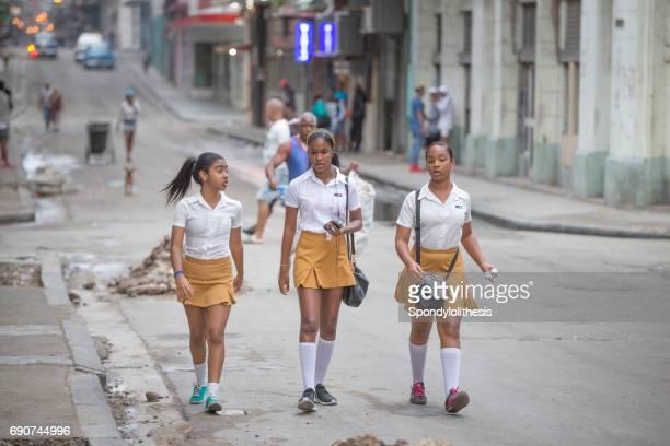 Drie SCHOOLKINDEREN, HAVANA, CUBA