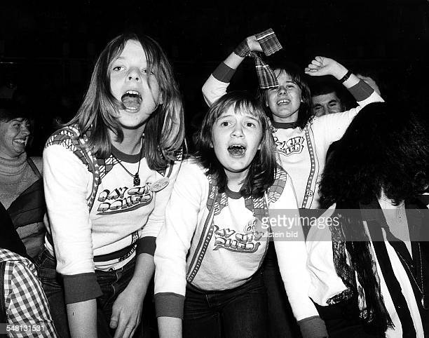 Three screaming girls at a Bay City Rollers concert 197580 Photographer Rudolf Dietrich Vintage property of ullstein bild