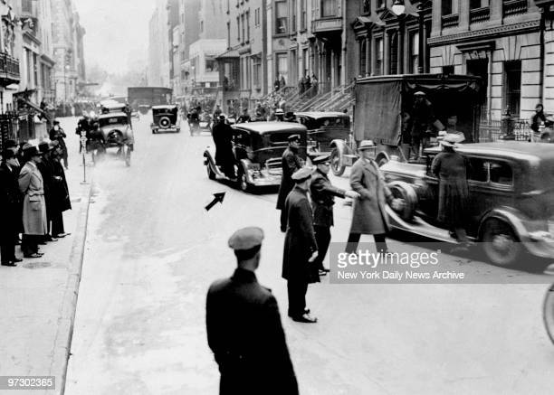 Three Secret Service men stand guard on running boards of Franklin D Roosevelt's car as he leaves his New York home for Washington DC