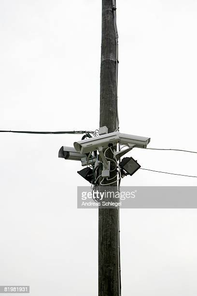 Three Security Cameras posted on a utility pole