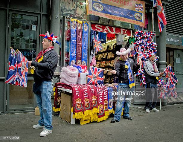 Three sellers outside a shop selling Royal Wedding merchandising and Union Flags. This was the day of Prince William wedding to Kate Middleton on the...